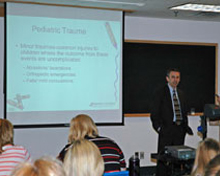 Pediatric Emergency Medicine Expert Dr. Emory Petrack teaching a class for health care workers.